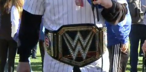 Kris Bryant wearing a WWE Championship Belt for Parade