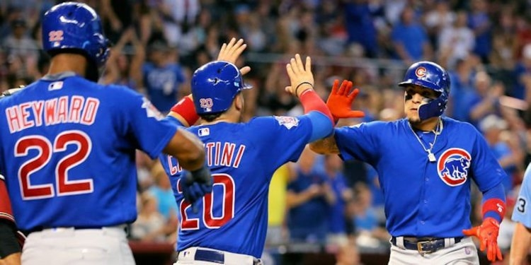 Combined with Kris Bryant's epic performance, Javier Baez's three-run jack helped lift the Cubs to a series win. Photo Credit: Mark J. Rebilas-USA TODAY Sports