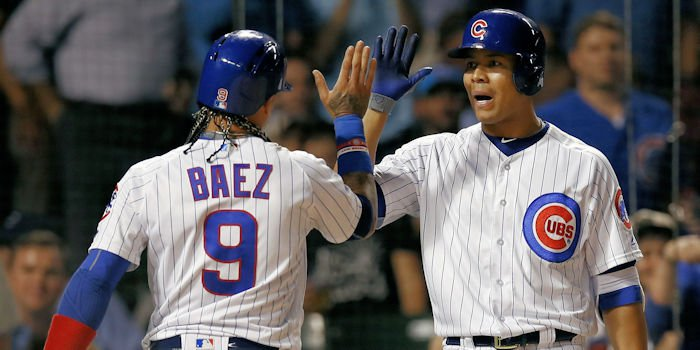Javier Baez (left) and Jose Quintana (right) were just a few of the Cubs to experience success at the plate in the blowout win for Chicago. (Photo Credit: Jim Young-USA TODAY Sports)