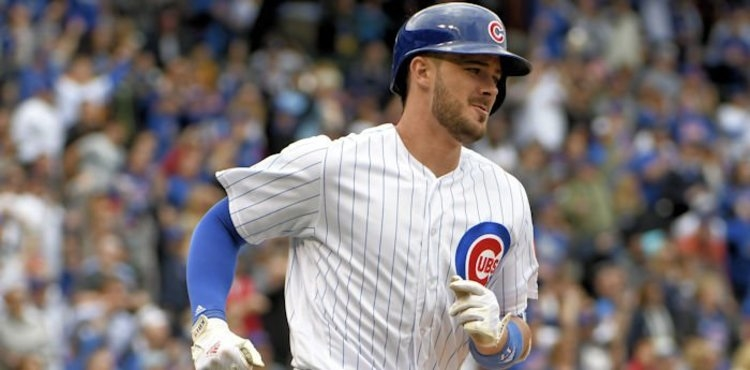 Kris Bryant (17) runs the bases after hitting a home run against the Milwaukee Brewers during the third inning at Wrigley Field. Credit: David Banks-USA TODAY Sports