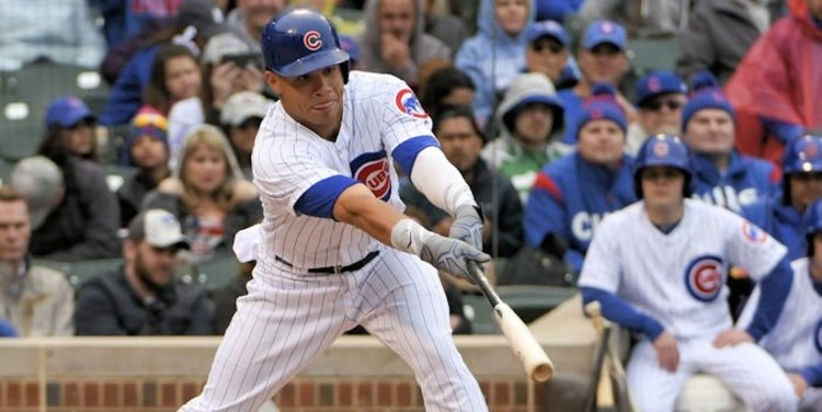 Brewers outlast Cubs in rain-soaked game