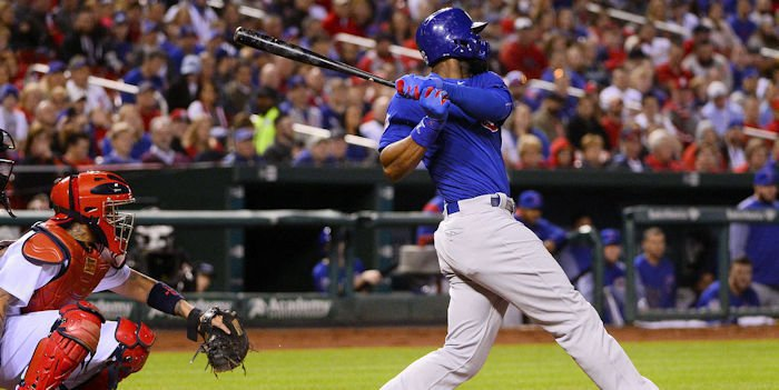 Chicago Cubs right fielder Jason Heyward (22) hits a one run single off of St. Louis Cardinals starting pitcher Adam Wainwright (50) during the fourth inning at Busch Stadium