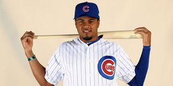 Cubs call up pitcher, option Candelario