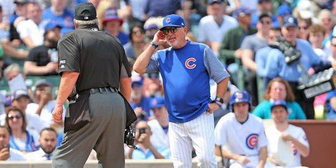 Chicago Cubs manager Joe Maddon (70) argues with umpire Joe West (22) during the first inning against the Pittsburgh Pirates at Wrigley Field. - Dennis Wierzbicki-USA TODAY Sports
