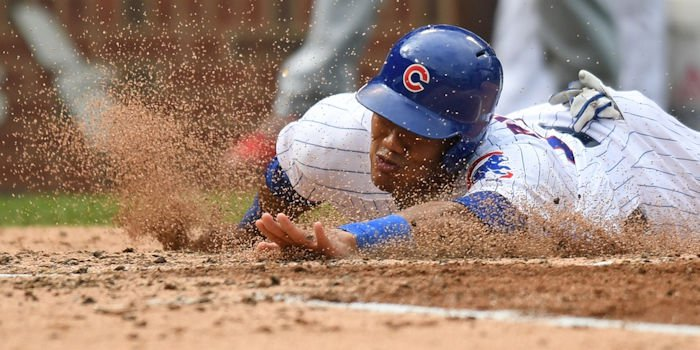 An overturned call involving an Addison Russell slide ruined a potential ninth-inning rally for the Cubs. (Photo Credit: Patrick Gorski-USA TODAY Sports)