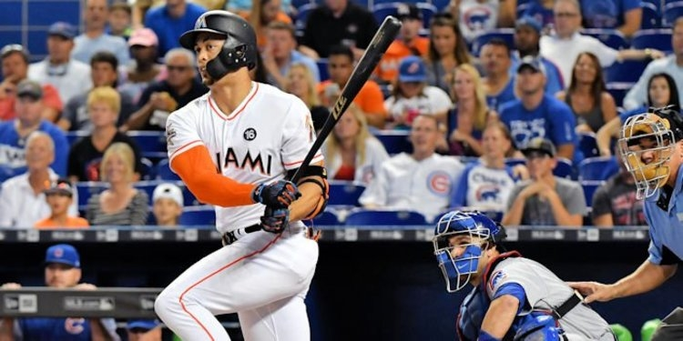 Giancarlo Stanton scored the game's first run on a long ball to center