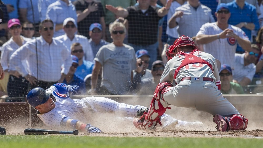 Albert Almora, Jr., scored what proved to be the winning run on an overturned call at the plate. (Photo Credit: Patrick Gorski-USA TODAY Sports)