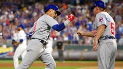 Led by Baez, Cubs overcome rain to dethrone Royals