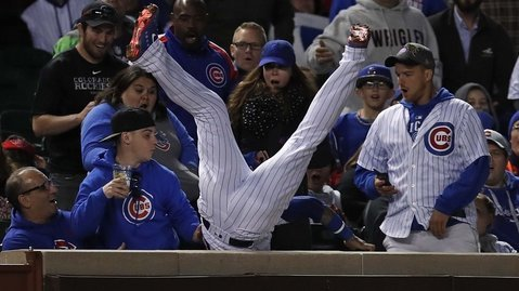 Javier Baez took a page out Derek Jeter's book on this phenomenal play in foul territory. (Photo Credit: Jim Young-USA TODAY Sports)