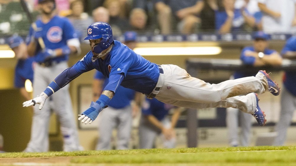 Chicago Cubs middle infielder Javier Baez scored a critical run by way of his tenacious base running. (Photo Credit: Jeff Hanisch-USA TODAY Sports)