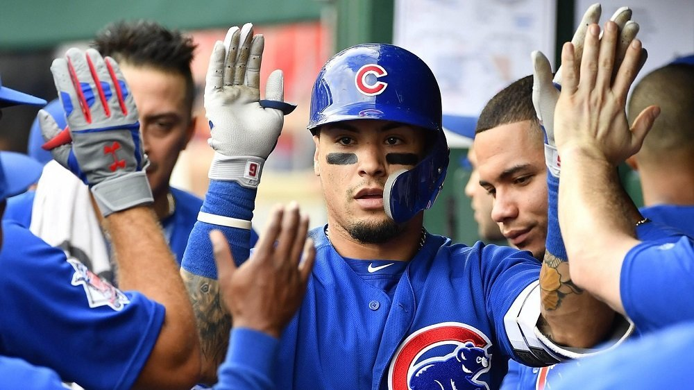A bunt by Javier Baez on a high pitch provided the Cubs with the winning run against the Nationals. (Photo Credit: Brad Mills-USA TODAY Sports)