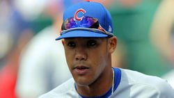 Former Cubs player Addison Russell signs with pro team
