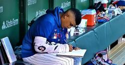 LOOK: Adbert Alzolay takes notes in dugout between innings