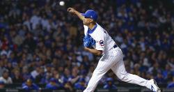 Cubs call up pitcher, place infielder on injured list