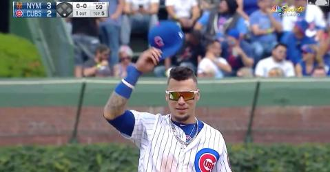 Javier Baez tipped his cap to the fans as if to playfully mock Adbert Alzolay.