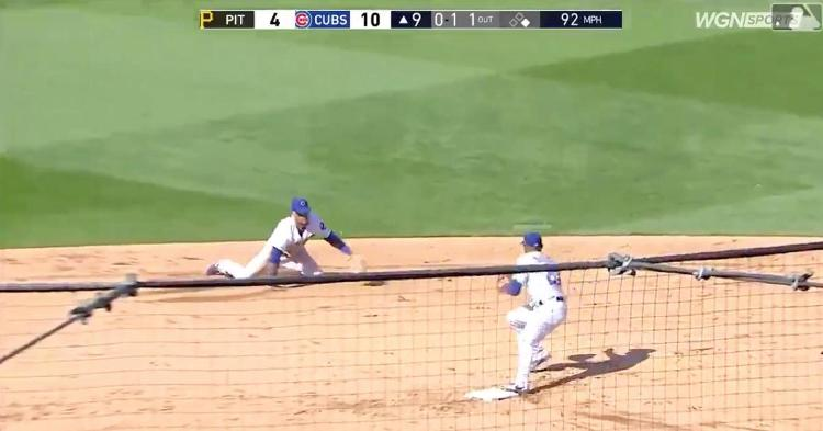 Javier Baez pulled off a jaw-dropping diving stop and ensuing glove flip as part of a game-ending double play.