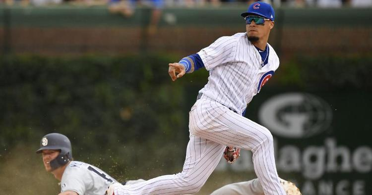 Javier Baez helped keep the Cubs' 1-run lead intact in the ninth inning by applying one of his signature no-look tags. (Credit: Quinn Harris-USA TODAY Sports)