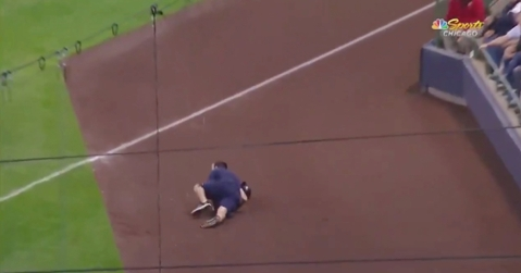 A ball boy at Miller Park gave it his all when laying out in an attempt at catching a line drive hit into foul territory.