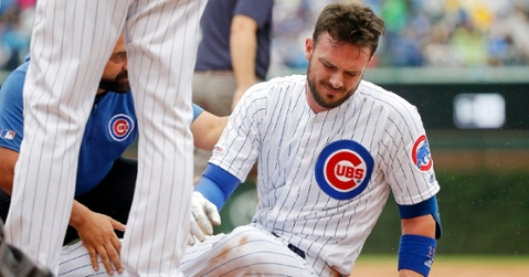 Kris Bryant was forced to leave Sunday's game after colliding with Jason Heyward in the outfield. (Credit: Jon Durr-USA TODAY Sports)