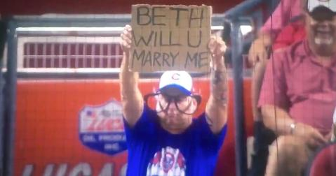 A drunk Cubs fan by the name of Jeremy asked an unlucky lady by the name of Beth to become his bride-to-be.