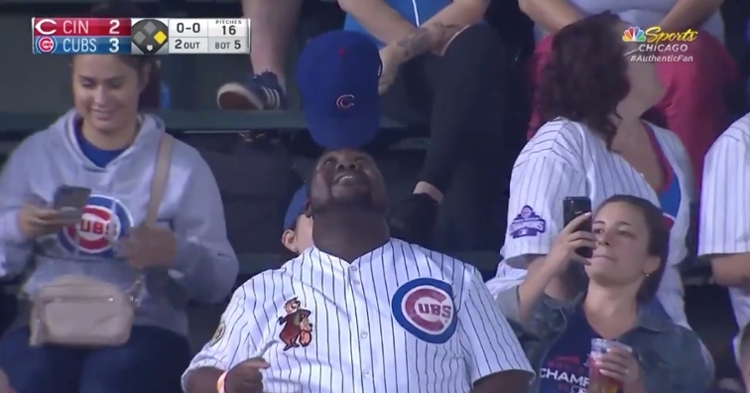 Chicago Cubs superfan Yogi was interviewed in the stands after performing his signature hat-balancing act at Wrigley Field.