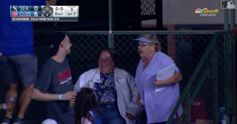 A fiery grandma lashed out at a couple of dudes who were attempting to get their grubby hands on her prized home-run ball.
