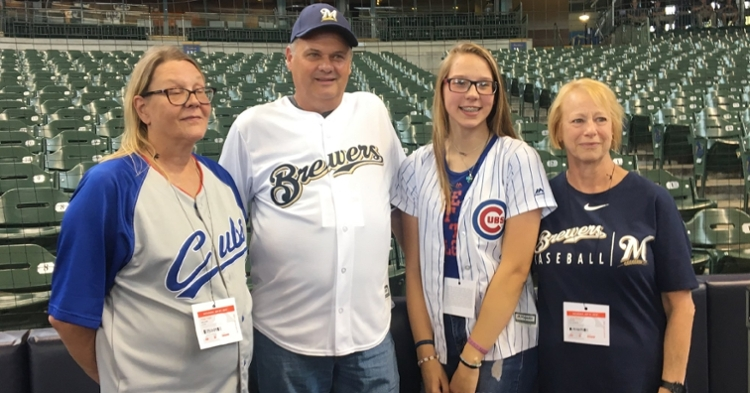 Brewers fan Tom Schroeder had the opportunity to meet the family of the Cubs fan from whom he received a heart last year. (Credit: @Aurora_Health on Twitter)