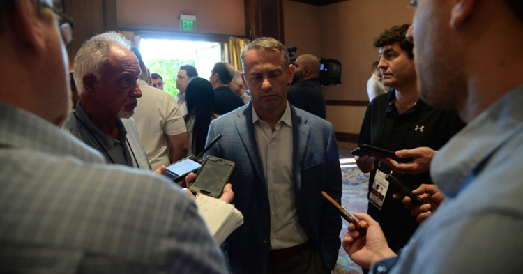 Jed Hoyer with reporters at the GM Meetings (Joe Camporeale - USA Today Sports)