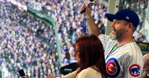 Megan Mullally and Nick Offerman sang out the seventh-inning stretch at Sunday's Cubs-Pirates game. (Credit: @Cubs on Twitter)