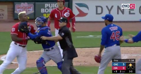 Yasiel Puig had to be stopped when charging toward Pedro Strop following a hit by pitch.