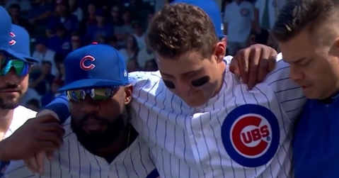 Chicago Cubs first baseman Anthony Rizzo was forced to leave the game after rolling his ankle while charging toward a bunted ball.