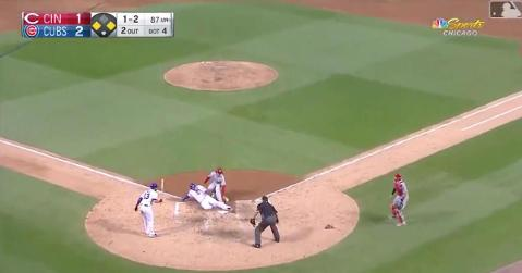 Cubs first baseman Anthony Rizzo galloped to the plate on a wild pitch and slid in safely.