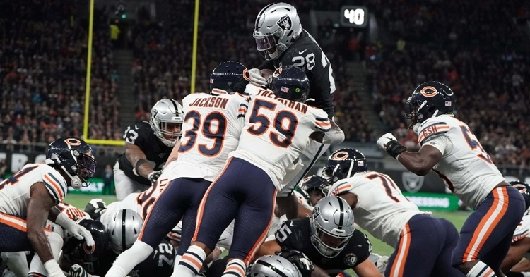 Raiders running back Josh Jacobs was able to power through a horde of Bears defenders while scoring the winning touchdown. (Credit: Kirby Lee-USA TODAY Sports)