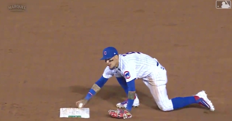 Javier Baez tagged second base in the most literal way possible, as he touched the bag with the baseball.