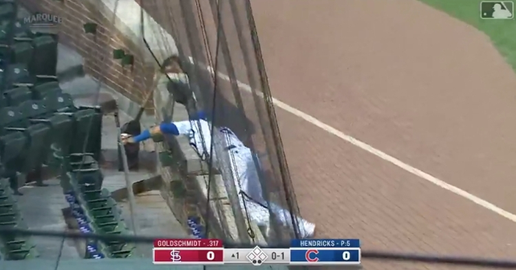 Javier Baez snagged a foulout while leaning into the protective netting on the left field side of Wrigley Field.