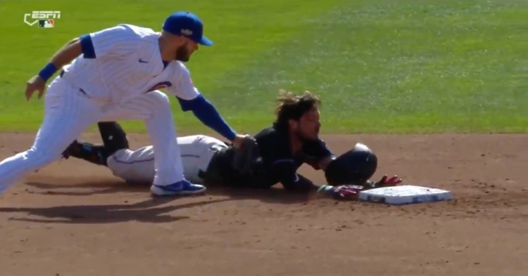 David Bote applied the tag on Miguel Rojas right before Rojas touched the bag.