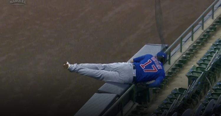 Kris Bryant tumbled over the partition in foul ground at Miller Park, ending his futile attempt at catching a foul ball.