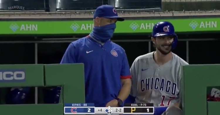 Kris Bryant could not help but laugh at David Ross' fiery exchange with an umpire.