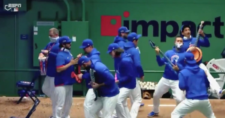 Fake musical instruments made for a rowdy home run celebration in the Cubs' bullpen.