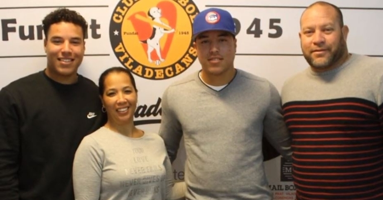 Hernandez with his family during his signing