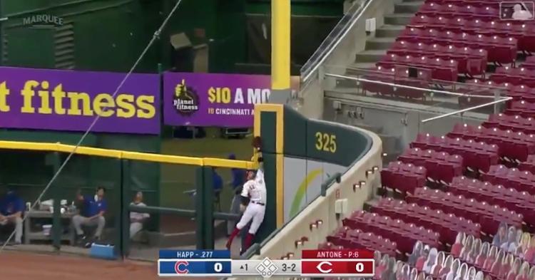 Former Cub Nicholas Castellanos made a futile attempt at catching Ian Happ's leadoff homer.