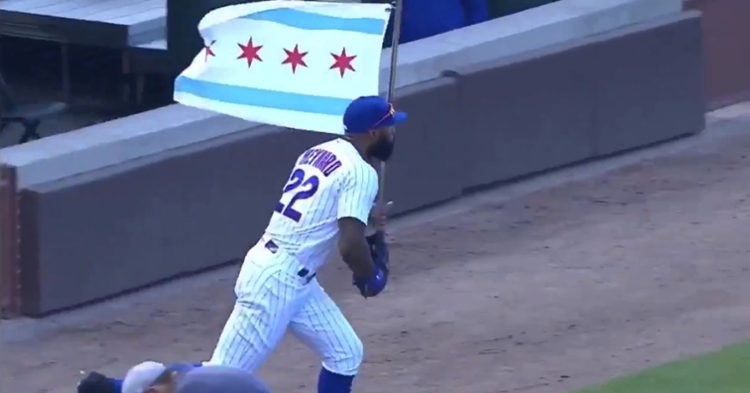 Jason Heyward proudly showed off the Chicago flag when taking the field on Friday evening.