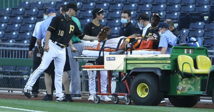Pittsburgh Pirates first baseman Phillip Evans was stretchered off the field after being injured in a scary collision. (Credit: Charles LeClaire-USA TODAY Sports)