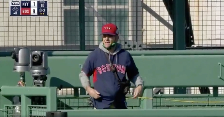 A fan somehow managed to sneak into Fenway Park in the midst of a game on Sunday afternoon.