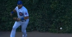 Kyle Schwarber reacts to being benched after defensive play