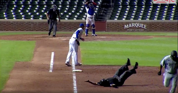 An umpire fell flat on his back while trying to get out of Edwin Encarnacion's way.