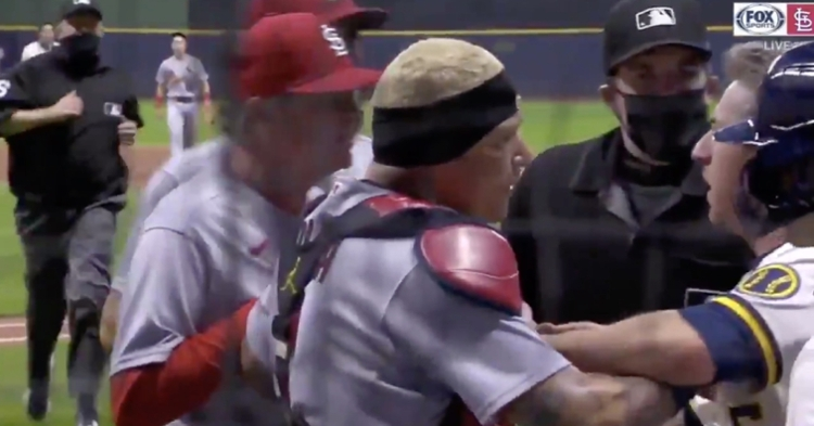 Cardinals catcher Yadier Molina was irate over something said to him from the Brewers' dugout.