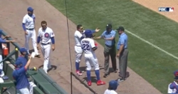 WATCH: Cubs bark at Brewers' dugout, have to be held back by umpires