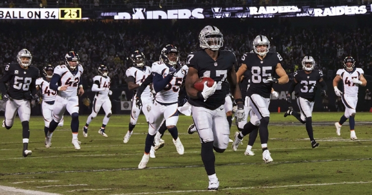 Harris scoring on a 99-yard punt return last season (Kelley Cox - USA Today Sports)