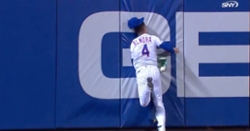 WATCH: Albert Almora Jr. crashes face-first into outfield wall